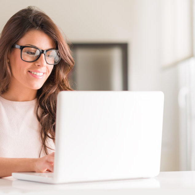 Happy Young Beautiful Woman Using Laptop, Indoors